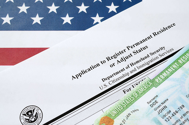 application to adjust status and green cards