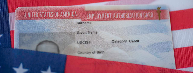 employment authorization card on american flag